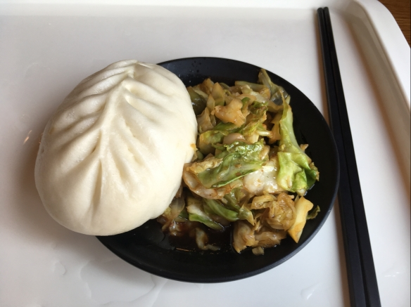 A Chinese steamed bun and some cabbage